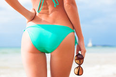Back view of fit young woman in green bikini with Stock Photography