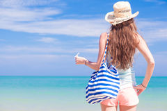 Back view of a fit young woman with stripy bag at Stock Photography