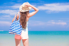 Back view of a fit young woman with stripy bag at Stock Photo