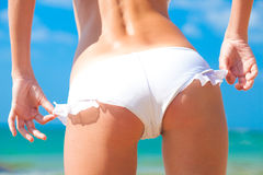 Back view of fit young woman in white bikini Royalty Free Stock Image