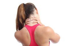 Back view of a fitness woman with neck pain. Isolated on a white background royalty free stock image