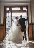 Bride and groom in front of vintage doors stock image