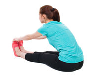 Back view of the girl sitting in front of a warm up exercise. Stock Photo