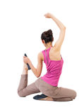 Back view of the girl sitting in front of a warm up exercise. Royalty Free Stock Photography