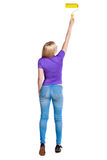 Back view of a girl who paints the paint roller. Stock Images