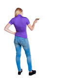 Back view of a girl who paints the paint roller. rear view people collection. Stock Image