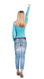 Back view of girl who try to fly like a superhero Royalty Free Stock Photos