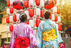Back view of girlfriends looking up at lantern Royalty Free Stock Image
