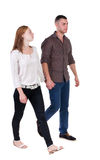 Back view going couple in shorts. Royalty Free Stock Images