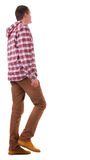 Back view of going  guy in a plaid shirt with hood Royalty Free Stock Images