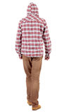 Back view of going  guy in a plaid shirt with hood Stock Image