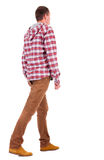 Back view of going  guy in a plaid shirt with hood. Royalty Free Stock Photo