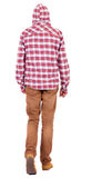 Back view of going  guy in a plaid shirt with hood. Stock Photography