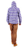 Back view of going  guy in a plaid shirt with hood Royalty Free Stock Image