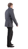 Back view of going  handsome business man in coat Royalty Free Stock Photos