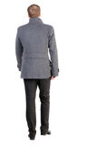 Back view of going  handsome business man in coat Royalty Free Stock Photography