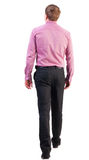 Back view of going  handsome business man in pink shirt Royalty Free Stock Photography