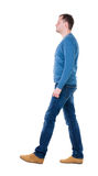 Back view of going  handsome man in blue pullover. Royalty Free Stock Image