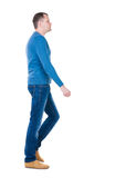 Back view of going  handsome man in blue pullover. Royalty Free Stock Photography