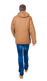 Back view of going  handsome man in brown parka. Stock Image