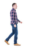 Back view of going  handsome man in checkered shirt. Royalty Free Stock Image