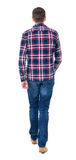 Back view of going  handsome man in checkered shirt. Royalty Free Stock Photos