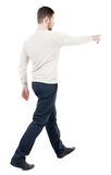 Back view of going  handsome man in jeans pointing Royalty Free Stock Images