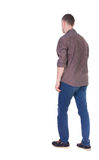 Back view of going handsome man in jeans and a shirt. Walking young guy . Rear view people collection. backside view of person. Isolated over white background Royalty Free Stock Photography