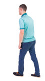 Back view of going  handsome man in jeans and a shirt. Walking young guy . Rear view people collection.  backside view of person.  Isolated over white Royalty Free Stock Photography