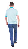 Back view of going handsome man in jeans and a shirt. Walking young guy . Rear view people collection. backside view of person. Isolated over white background Stock Photo