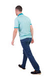 Back view of going  handsome man in jeans and a shirt. Stock Image
