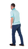 Back view of going  handsome man in jeans and a shirt. Walking young guy . Rear view people collection.  backside view of person.  Isolated over white Stock Photos
