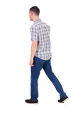 Back view of going handsome man in jeans and a shirt. Walking young guy . Rear view people collection. backside view of person. Isolated over white background stock images