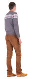 Back view of going  handsome man in jeans and sweater Royalty Free Stock Photo
