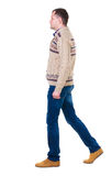 Back view of going  handsome man in jeans and warm sweater. Stock Image