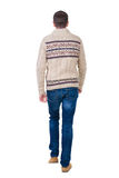 Back view of going  handsome man in jeans and warm sweater. Royalty Free Stock Photo