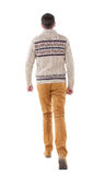 Back view of going  handsome man in a knitted sweater Stock Photo