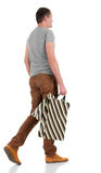 Back view of going  handsome man with shopping bags. Royalty Free Stock Photos