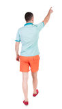 Back view of going  handsome man in shorts.  walking young guy Royalty Free Stock Images