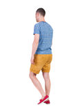 Back view of going  handsome man in shorts.  walking young guy Stock Images
