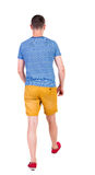 Back view of going handsome man in shorts. walking young guy. Rear view people collection. backside view of person. Isolated over white background. The guy in stock photo