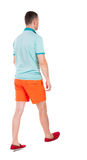 Back view of going  handsome man in shorts.  walking young guy Royalty Free Stock Image