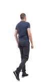 Back view of going  handsome man Stock Images