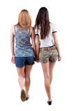 Back view going of two young woman Royalty Free Stock Photo