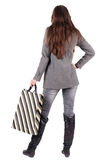Back view of going  woman  in  coat woman with shopping bags Stock Photography