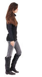 Back view of going  woman  in jeans and sweater Royalty Free Stock Image
