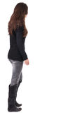 Back view of going  woman  in jeans and sweater Royalty Free Stock Photo