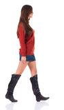 Back view of going  woman  in  in jeans and sweater Royalty Free Stock Images