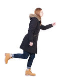 Back view of going  woman in parka. Royalty Free Stock Photo