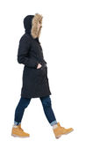 Back view of going  woman in parka. Royalty Free Stock Images